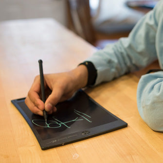 Boy at table using Jot