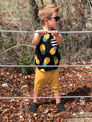 Yellow Modern Striped Harem Pants & Shorts, modeled by fence
