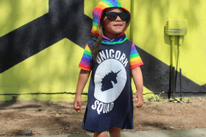 Unicorn Squad Rainbow Romper/Dress/Hoodie, modeled with hood