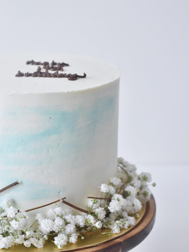 Close up of White & Blue Baby Breath Cake Singapore - Zee & Elle