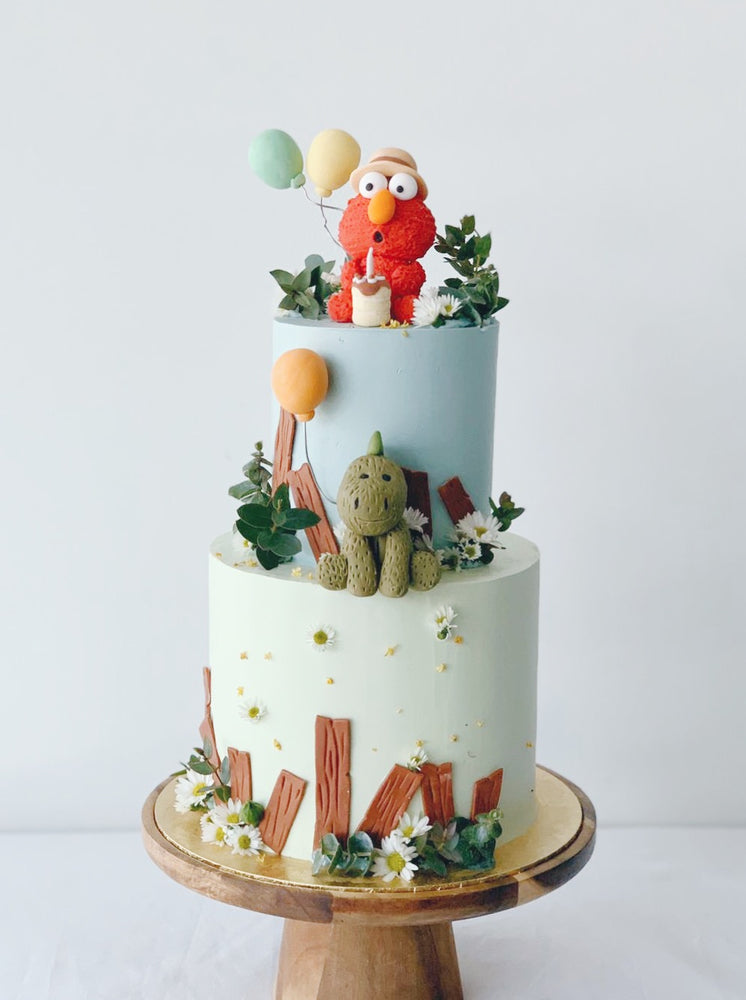 Elmo and Dino on  two tier garden cake -zeeandelle
