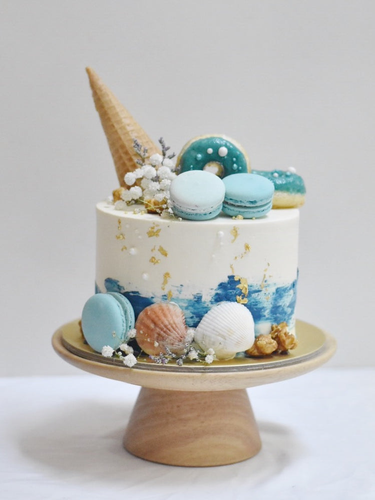 Seashells with blue strokescake - zeeandelle