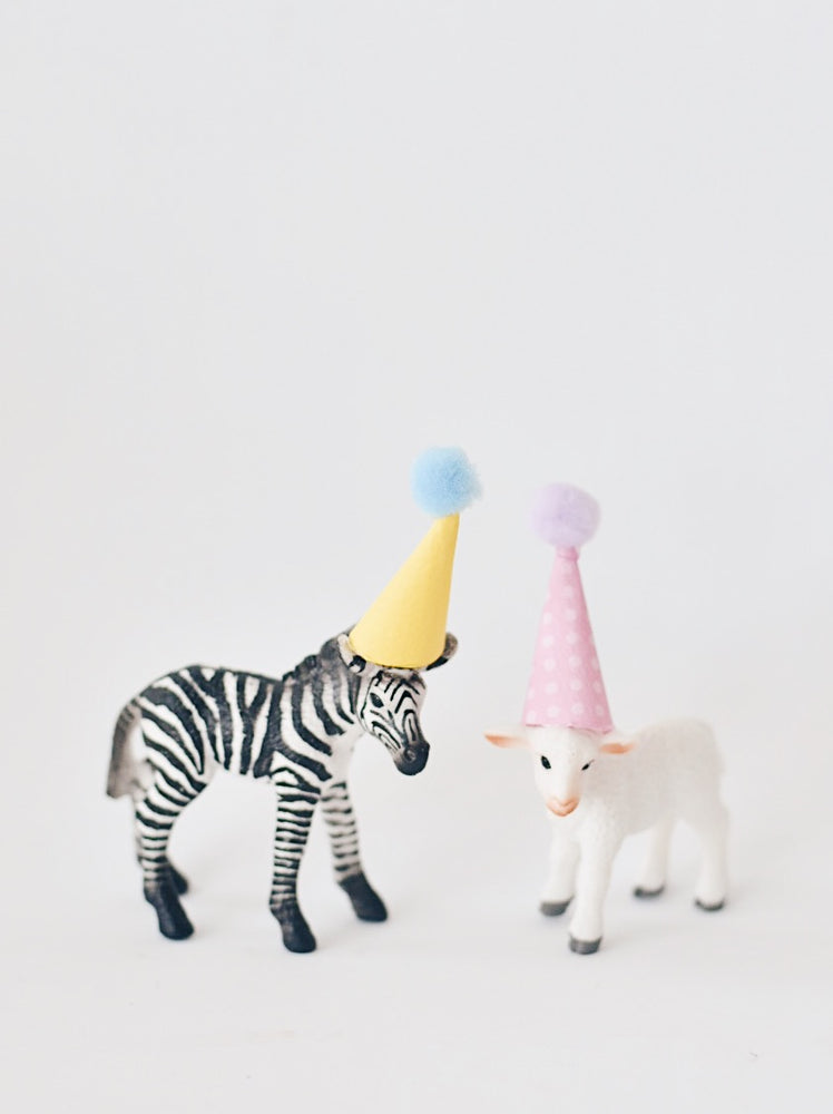Toy animal with party hat cake topper