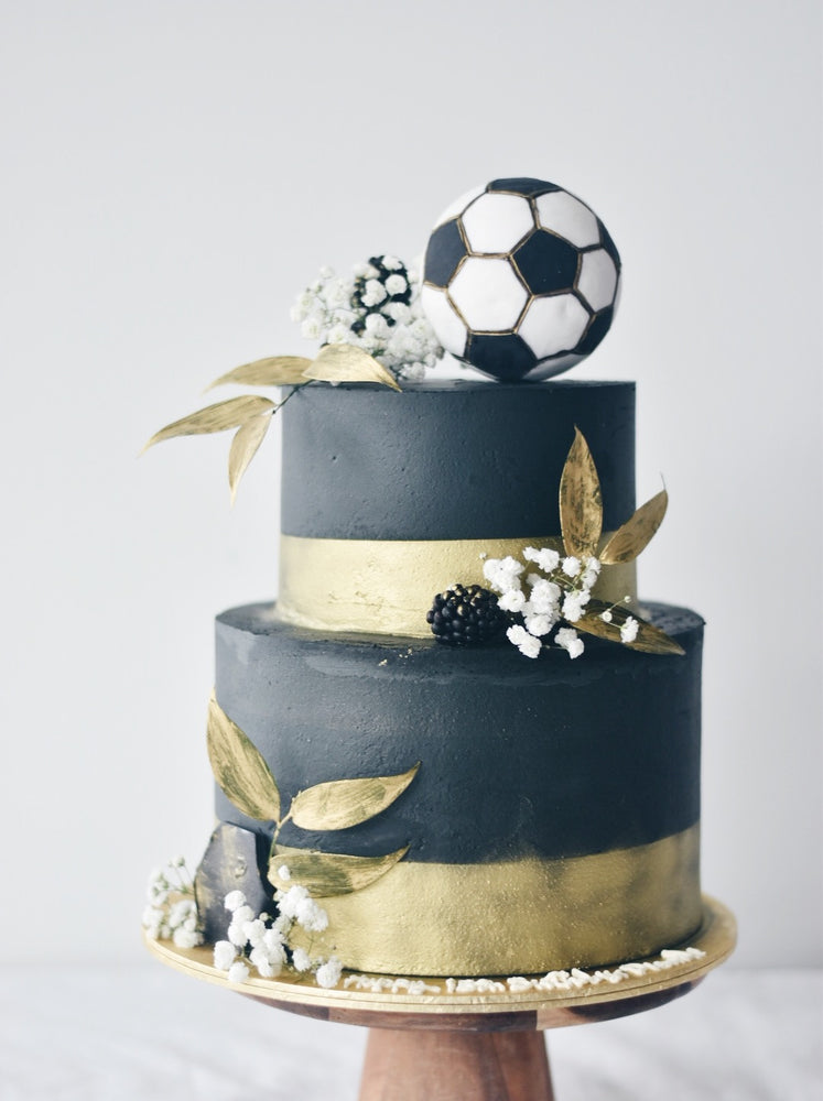 Two-Tier Soccer Black & Gold Cake - zeeandelle