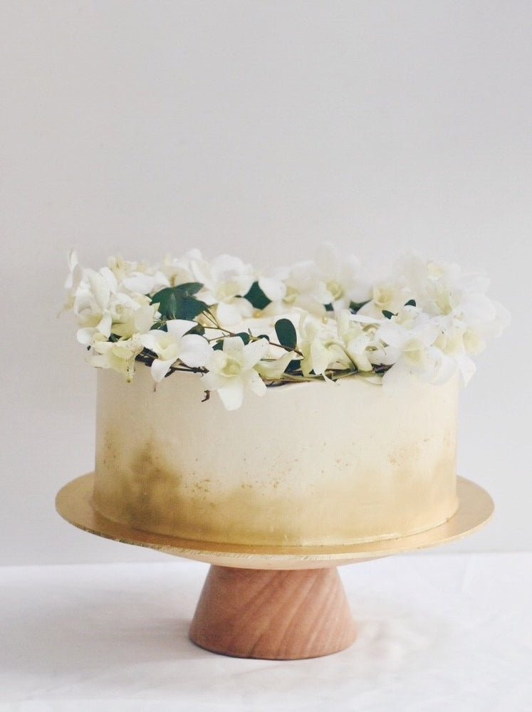 White orchids on white and gold cake -zeeandelle