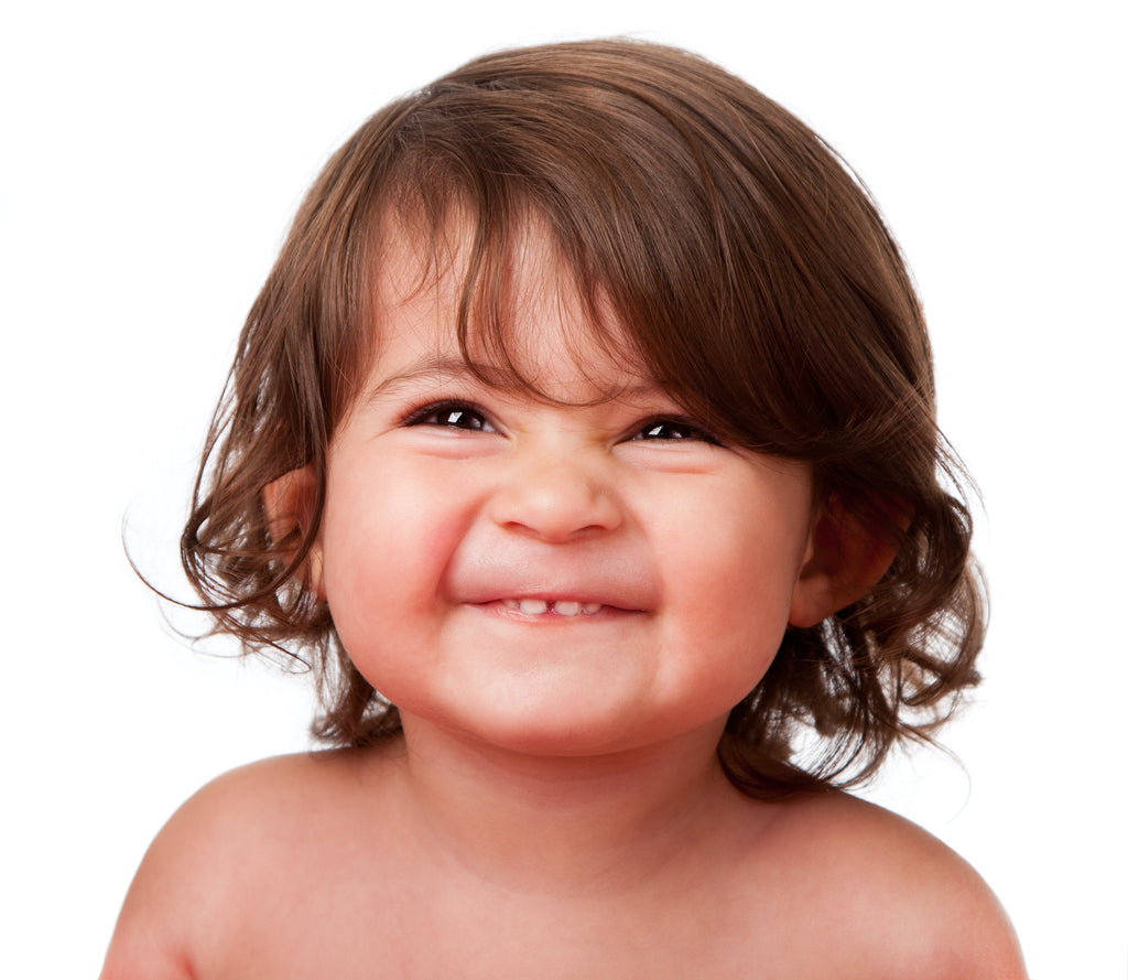 Grinning curly haired toddler