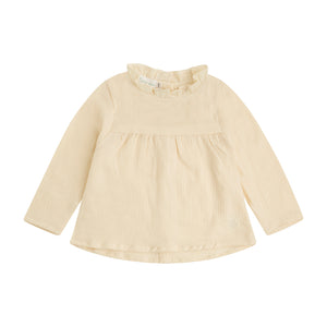 cream colored soft bambula blouse with gathered collar, empire waist and wooden buttons down the back