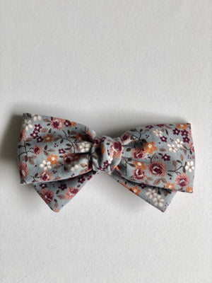 Bow with knot and metal snap clip.  11cm x 6.5cm