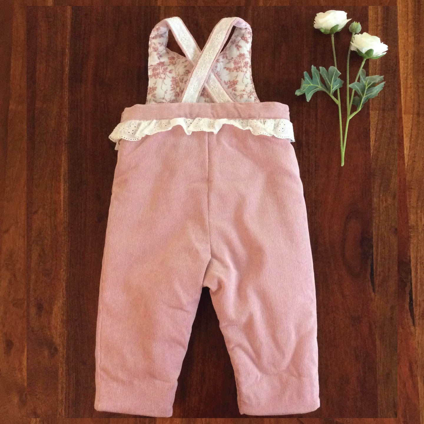 back side rose colored baby girl corduroy overalls