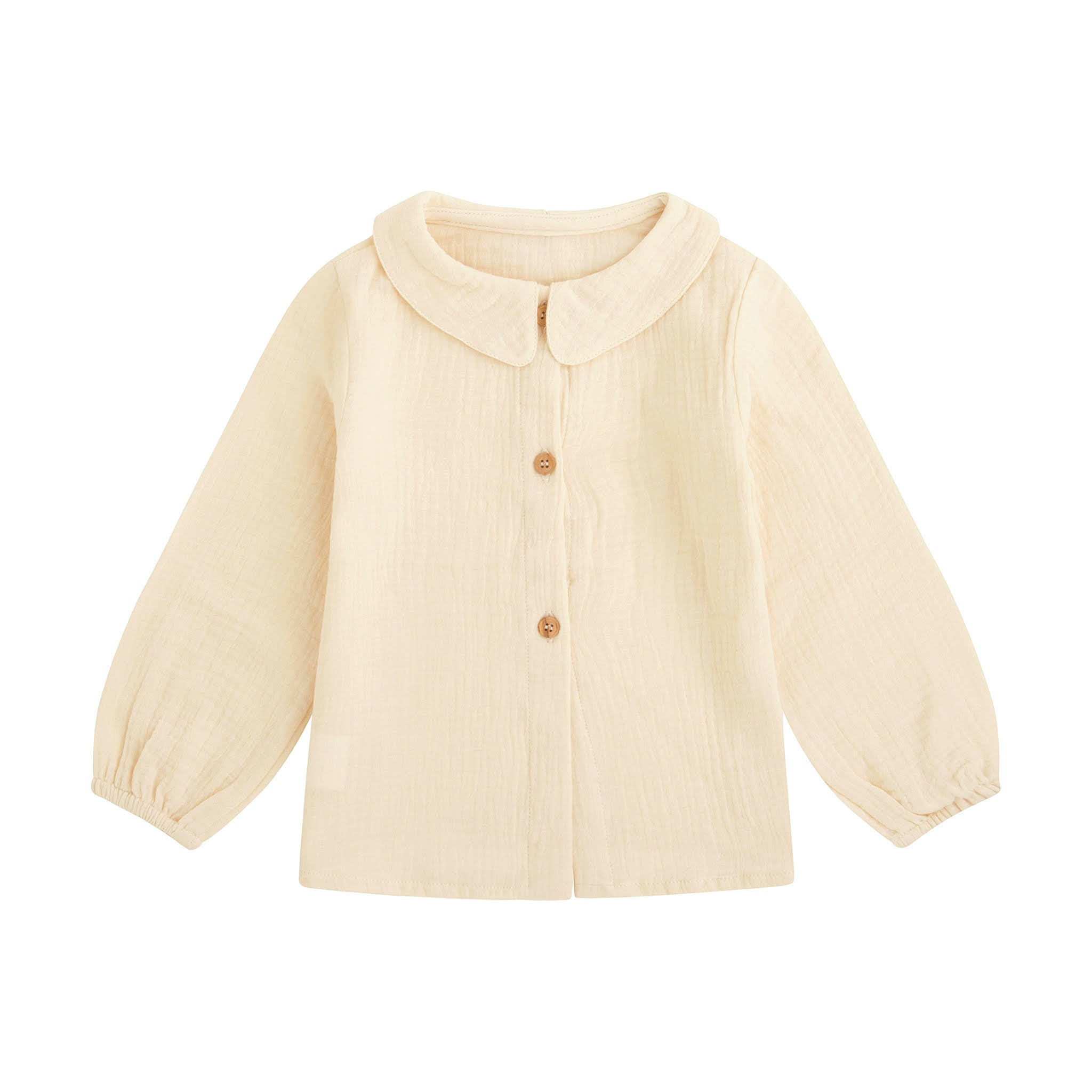 cream baby blouse in soft bambula with peter pan collar and wooden buttons down the back
