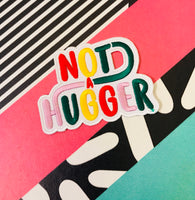 Not a Hugger 4 inch iron on patch, designed by latenightcrew AU.