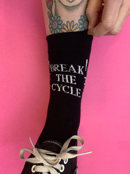 Break the Cycle black socks with wrap around text, size 5-10).