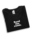 Read the room. Unisex black shirt, soft cotton.