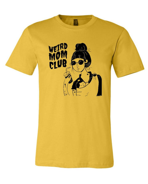 New Weird Mom Club Logo on a mustard or gold shirt.
