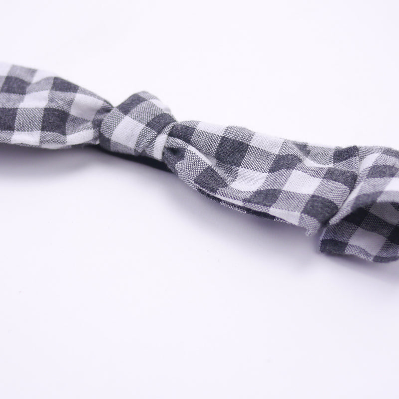 Black and white gingham bow headband with soft comfort elastic closeup