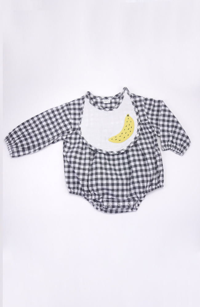 Laz black and white gingham long sleeved romper with applique banana bib for babies