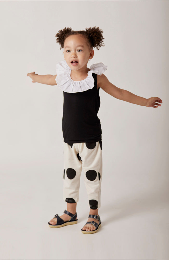 Raphaelle polka dot french terry sweatpants with pockets in black and white for babies and kids front view
