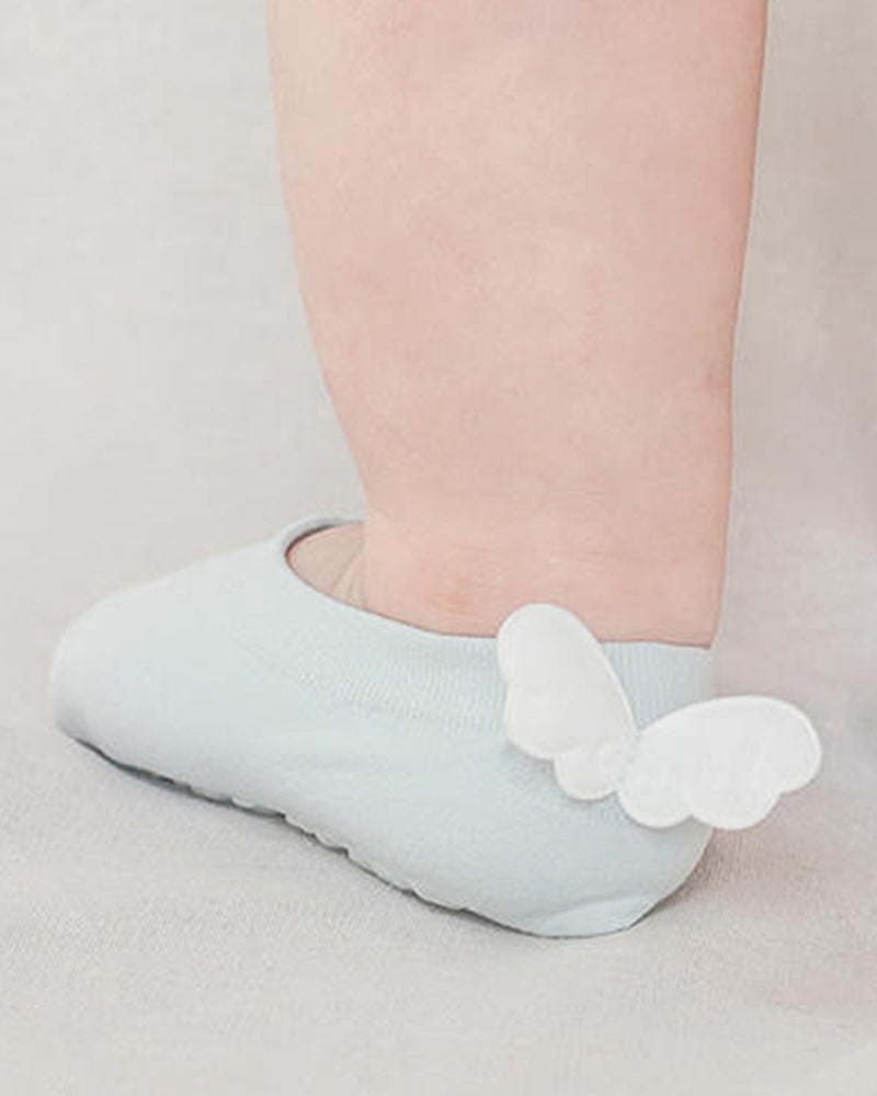 Baby blue low cut ankle songs with adorable puffy angel wings at the back heel