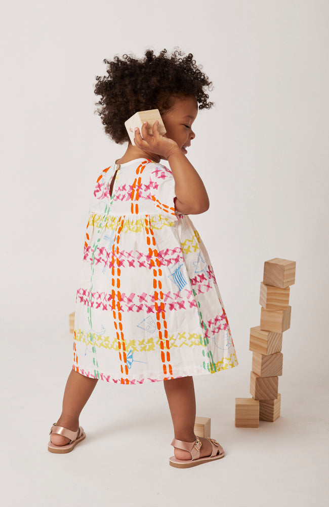Beatrice cap sleeved A-line dress in an artistic and lively summer cotton print back