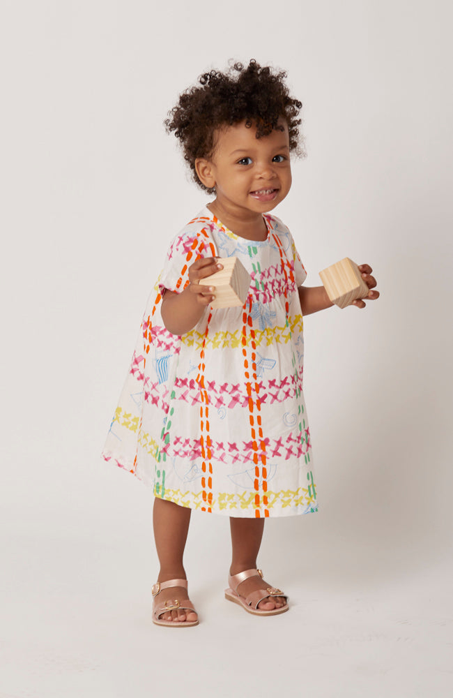 Beatrice cap sleeved A-line dress in an artistic and lively summer cotton print front