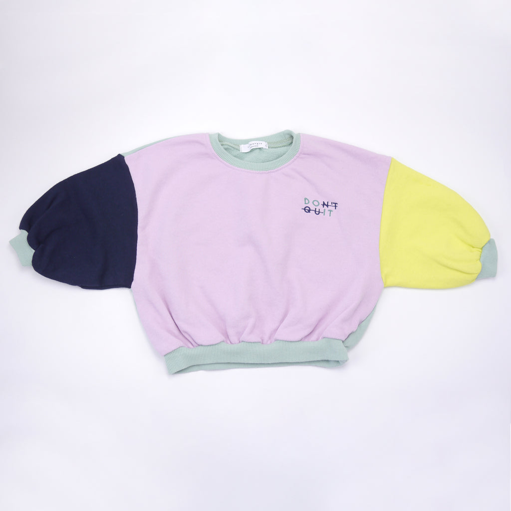 "Caroline color blocked light weight french terry sweatshirt donning an embroidered ""DON'T QUIT"" logo for kids"