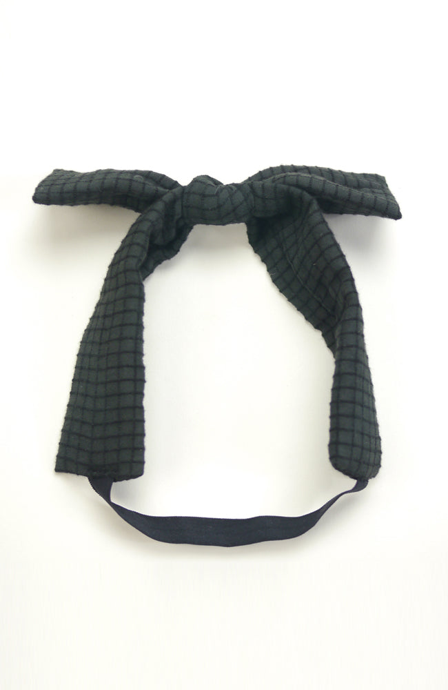 Chloe bow head band is made with black check textured fabric for babies and kids
