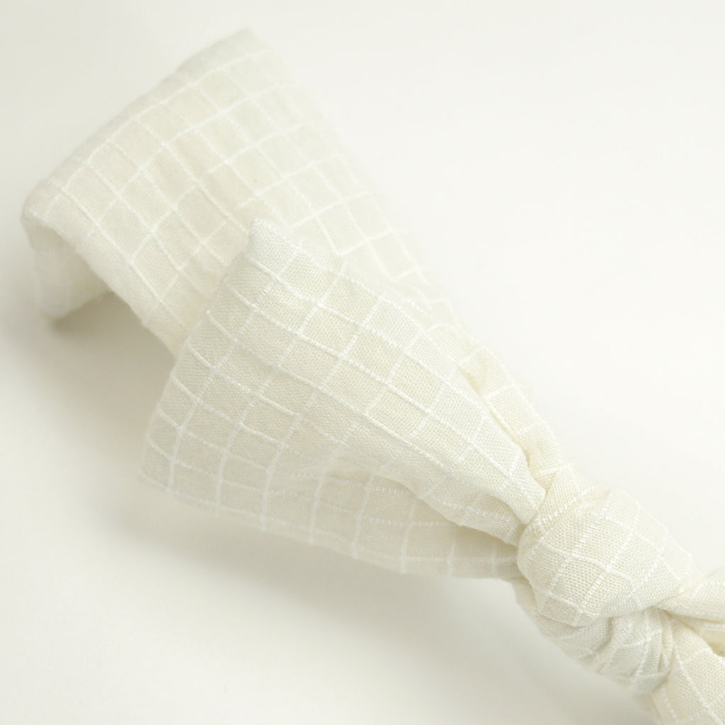 Chloe bow head band is made with white check textured fabric for babies and kids