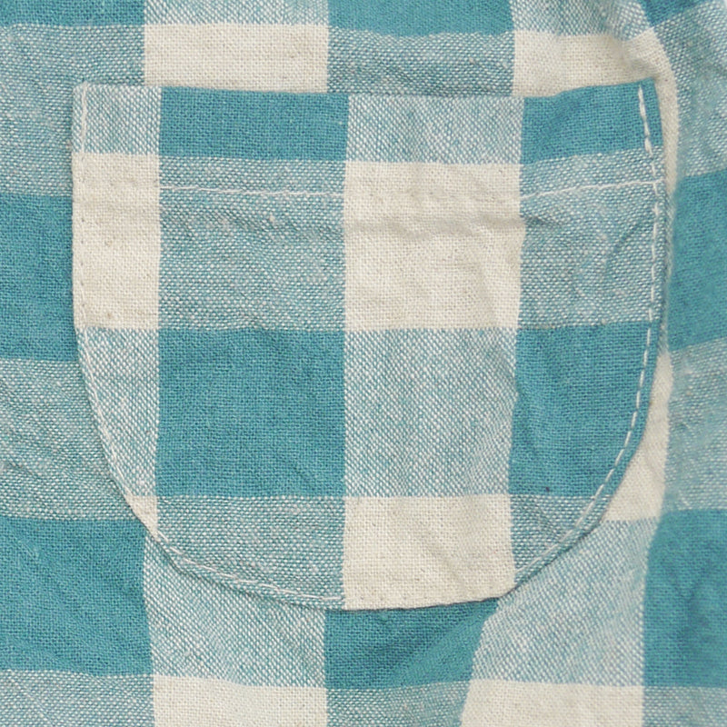 Eugene green checkered gingham print with one front patch pocket for babies close up