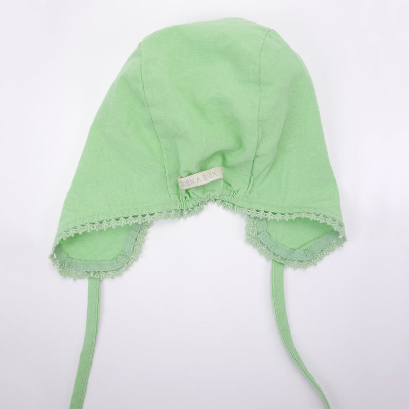 Eze lace baby bonnet in bright neon green cotton linen back view