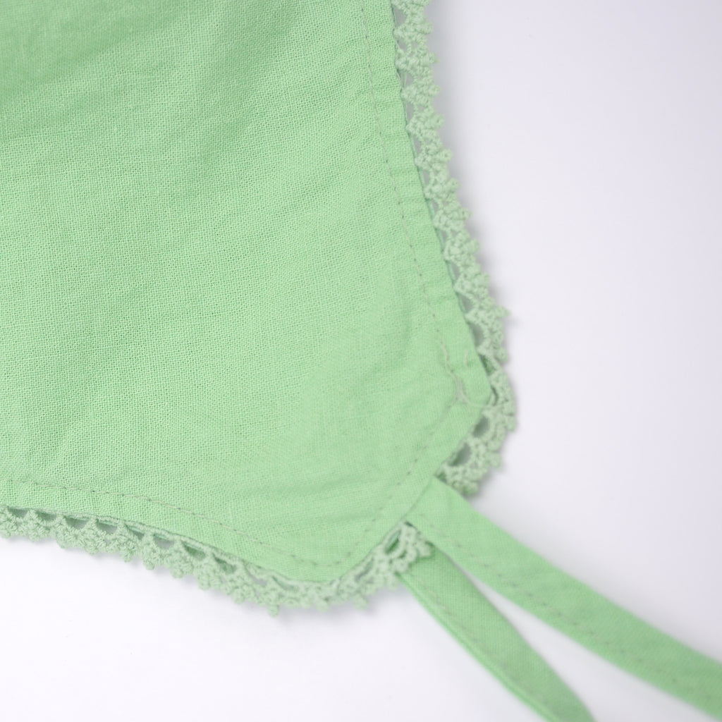Eze lace baby bonnet in bright neon green cotton linen with ties and crochet detail