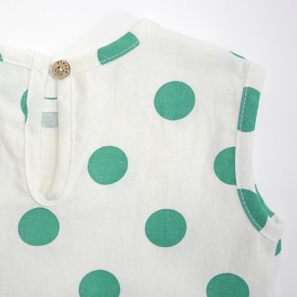 Happy sleeveless baby romper with green polka dots back keyhole with button detail