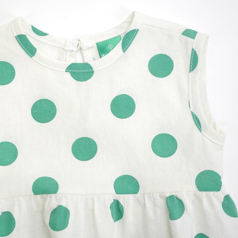 Happy sleeveless baby romper with green polka dots front neckline