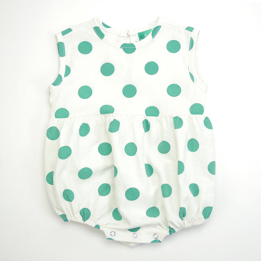 Happy sleeveless baby romper with green polka dots and snaps front view