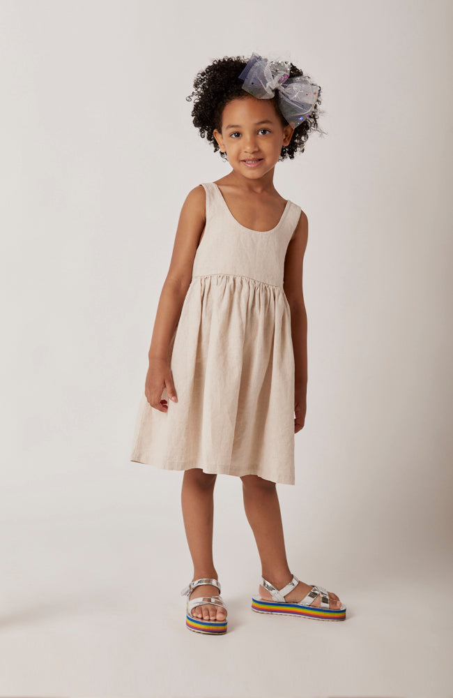 Isabelle sleeveless dress in beige with contrasting black ribbon ties for kids full front view