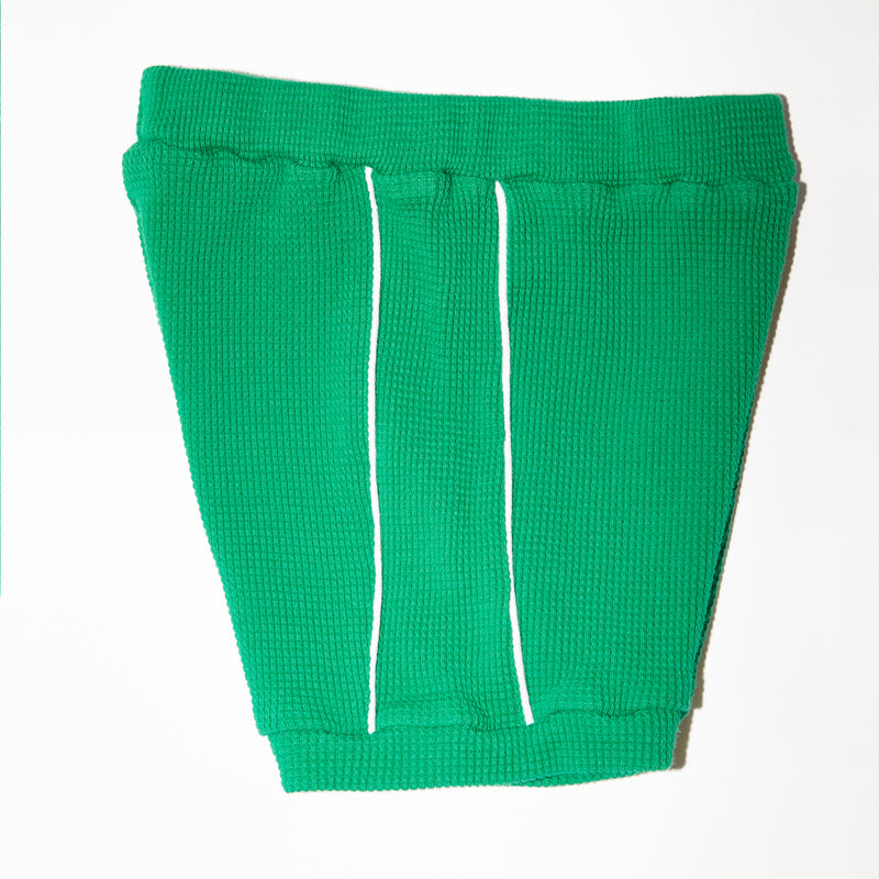 Jojo green waffle knit textured short with white piping for babies and kids side view