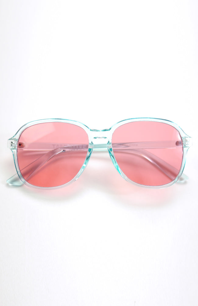 Luca translucent green frame sunglasses with rose colored lenses with UV protection for kids front view
