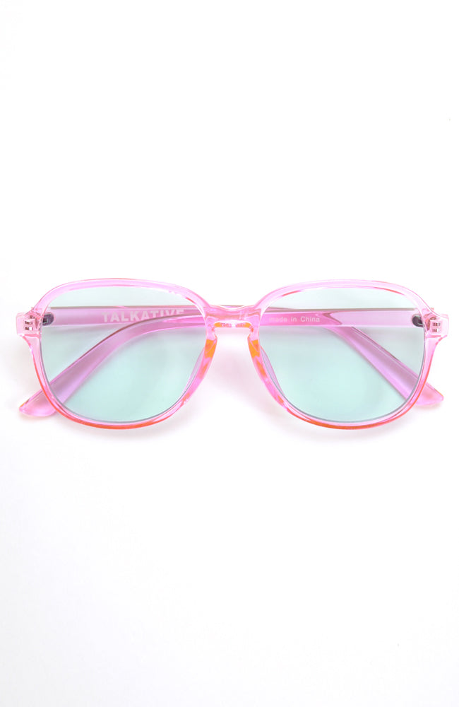 Luca translucent pink frame sunglasses with mint colored lenses with UV protection for kids front view