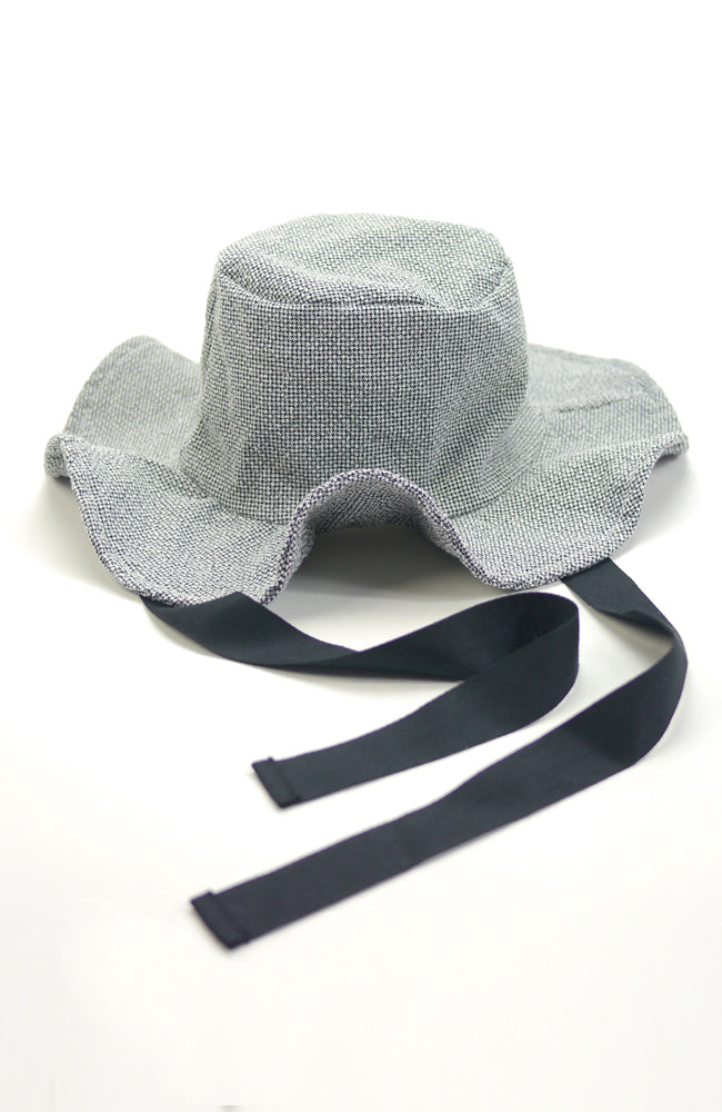 Lucille wide brimmed sun hat in textured grey fabric with black ribbon ties for kids front