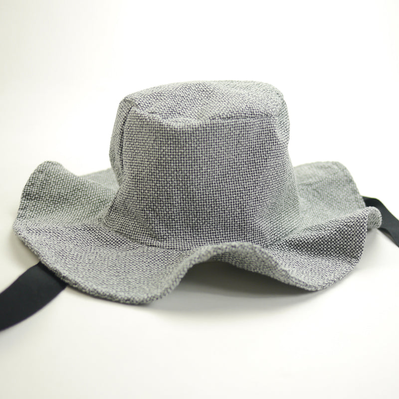 Lucille wide brimmed sun hat in textured grey fabric with black ribbon ties for kids