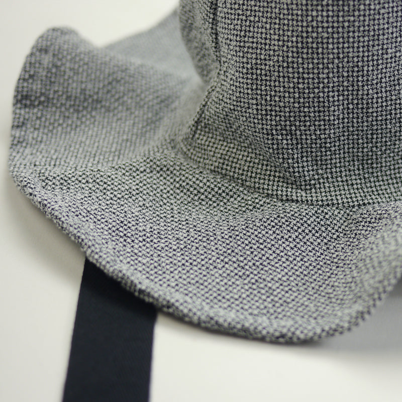 Lucille wide brimmed sun hat in textured grey fabric with black ribbon ties for kids fabric closeup