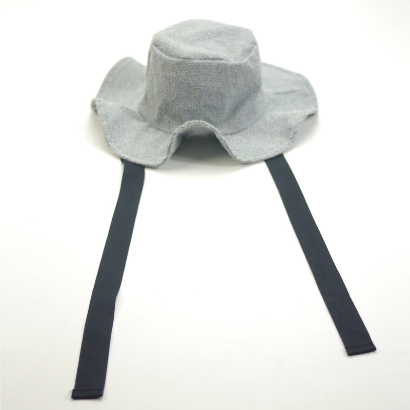 Lucille wide brimmed sun hat in textured grey fabric with black ribbon ties for kids aerial view