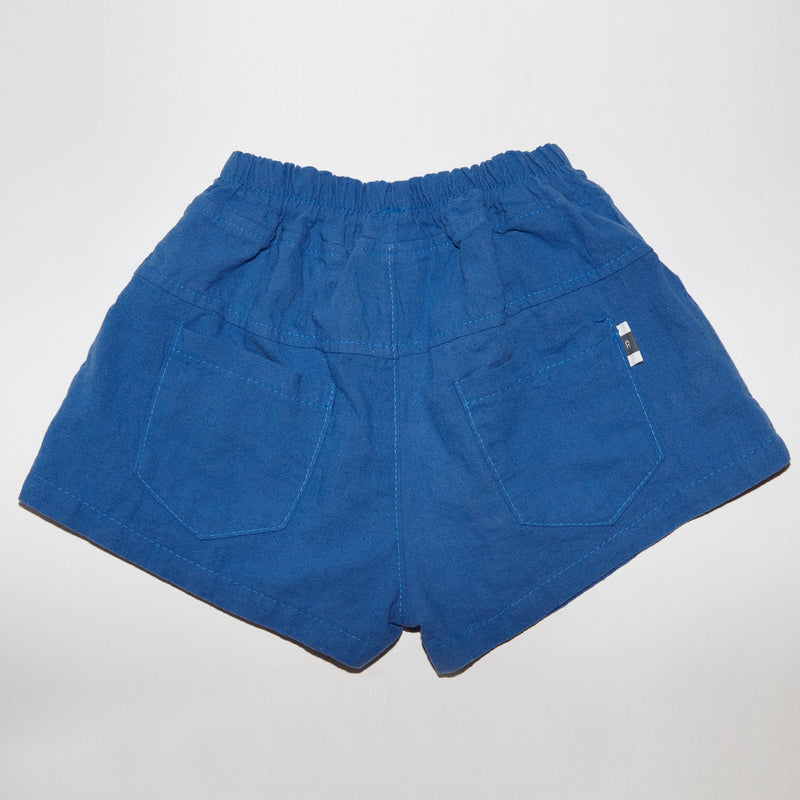 Max shorts in blue with front and back pockets with yoke detail for babies and kids back view