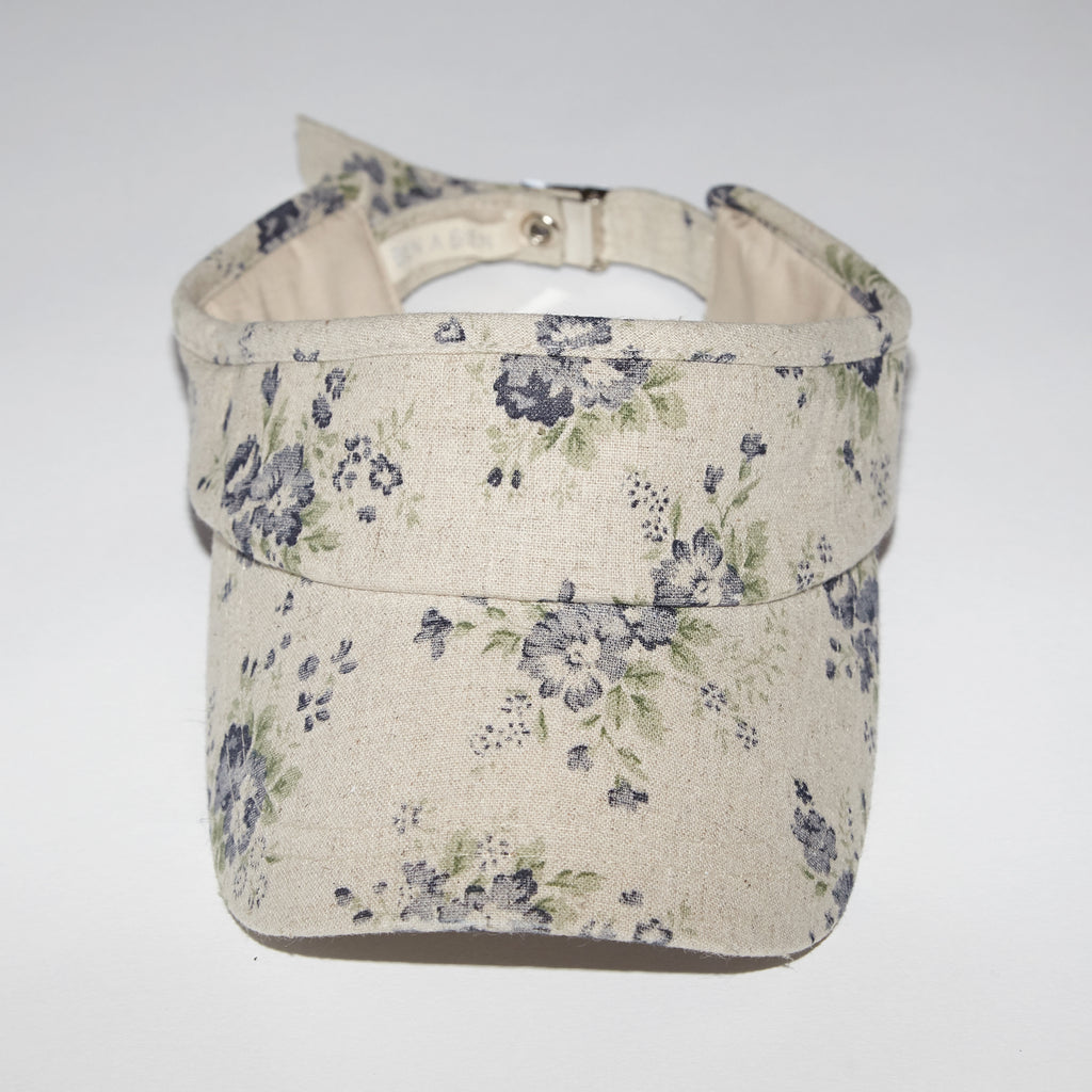 Flora navy floral print cotton visor style hat for babies and kids front view
