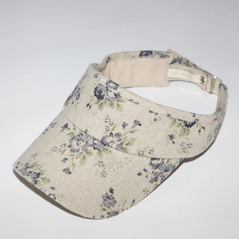 Flora navy floral print cotton visor style hat for babies and kids side view