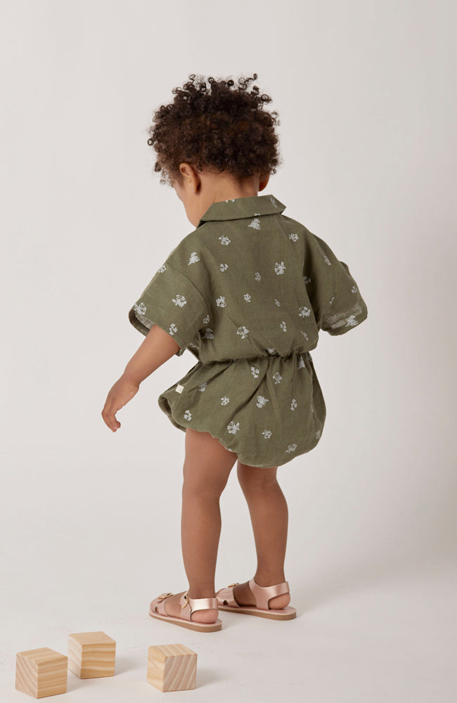 Nico collared one-piece romper in a green floral for babies front view