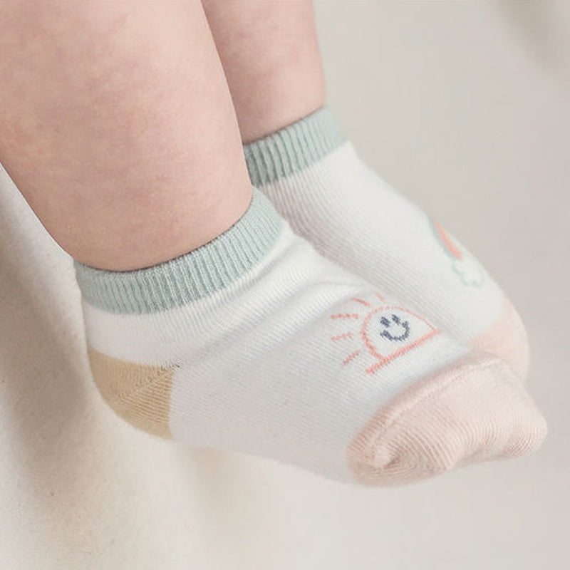 sunshine and rainbow motif on short crew length socks in pink and mint