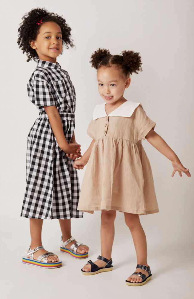 Sylvie short sleeved sailor collared dress with front buttons for toddlers and kids and sam button up and maia checkered skirt