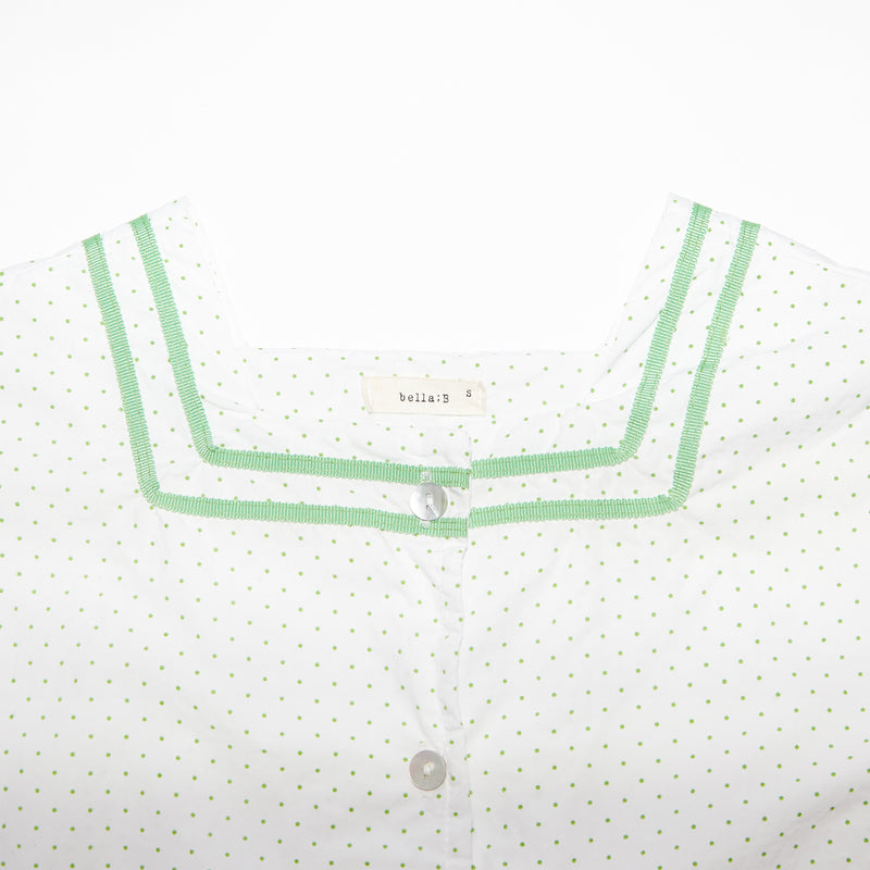 Simone white and green polka dots square neck top for toddlers and kids front closeup