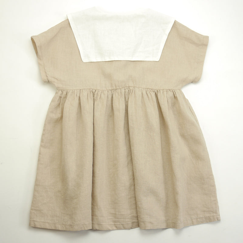 Sylvie short sleeved sailor collared dress with front buttons for toddlers and kids back view