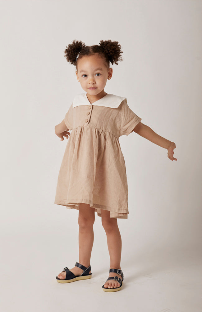 Sylvie short sleeved sailor collared dress with front buttons for toddlers and kids front view